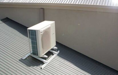 Installing Air Conditioner on the pitched roof.